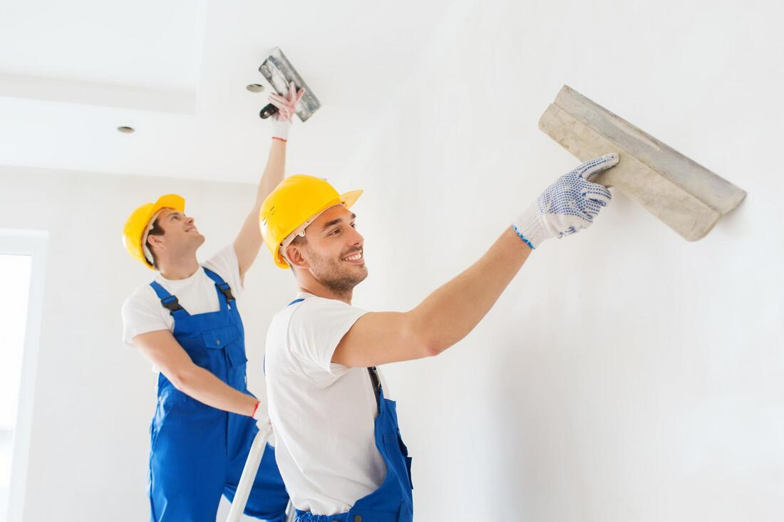 professional drywall worker doing commercial drywall project